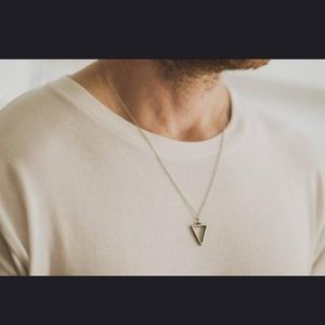 Necklace with a silver triangle pendant